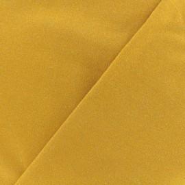 Tissu sweat léger Molletonné Pailleté - moutarde x 10cm