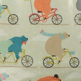 Tissu coton enduit Ours à bicyclette - écru x 32cm