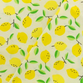 Coated fabric Lemon - ivory background x 10cm