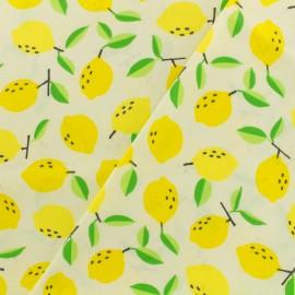 Tissu coton enduit Mini citrons - ivoire x 10cm
