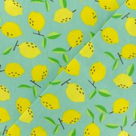 Tissu coton enduit Mini citrons - turquoise x 10cm