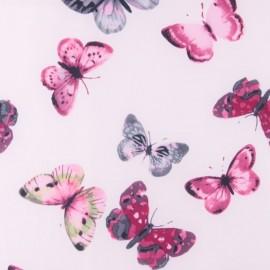 Tissu déperlant souple Envolée de papillons - rose dragée x 10cm