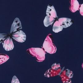 Tissu déperlant souple Envolée de papillons - bleu nuit x 10cm