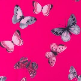 Tissu déperlant souple Envolée de papillons - fuchsia x 10cm