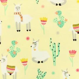 Jersey cotton fabric Como te llamas ? - jaune x 10cm