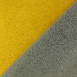 Tissu polaire réversible bicolore - jaune/gris x 10cm