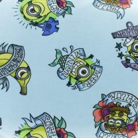 Tissu jersey Tattoo Minions - bleu ciel x 10cm