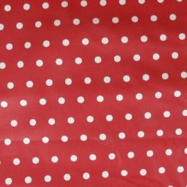 Tissu enduit coton petits pois fond rouge