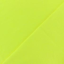 Tissu Jersey tubulaire - jaune fluo x 10cm