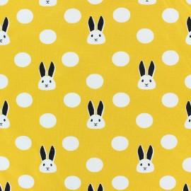 Tissu coton jersey Stenzo lapin - jaune x 10cm