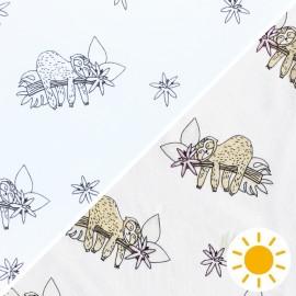 Tissu Jersey Photosensible Paresseux - blanc x 10cm