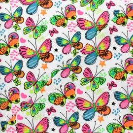 Tissu jersey Papillon fluo - blanc x 10cm