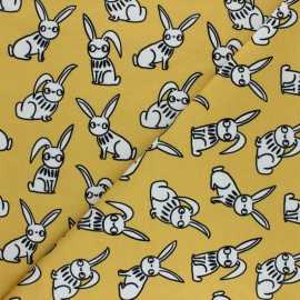 French terry fabric - yellow mustard Funny rabbits x 10cm