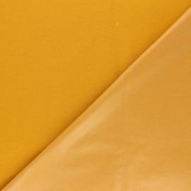 Tissu PUL jersey coton uni - jaune moutarde x 10cm