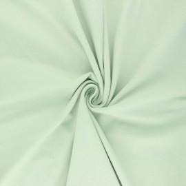 Tissu jersey uni Bio - vert amande x 10cm