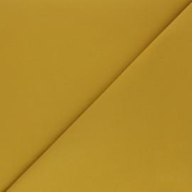 Tissu Gabardine élasthanne mat - jaune moutarde x 10cm