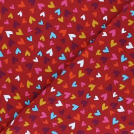 Printed Jersey fabric - red brick Pluie de coeurs x 10cm
