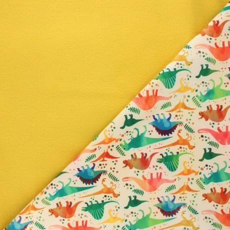 Softshell fabric - yellow Dino club x 10cm