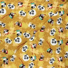 Tissu jersey Kung Fu Panda bamboo - jaune moutarde x 10cm