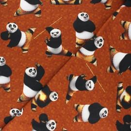 French terry fabric - rust  Kung Fu panda x 10cm