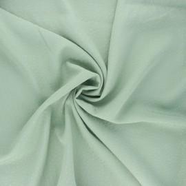 Tissu viscose plumetis brodé - vert sauge x 10cm
