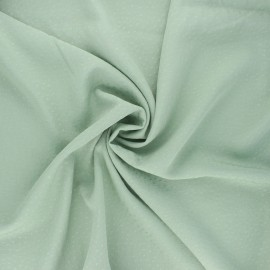 Viscose fabric with embroidered plumetis - sage green x 10cm