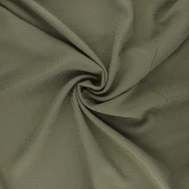 Tissu viscose plumetis brodé - kaki x 10cm