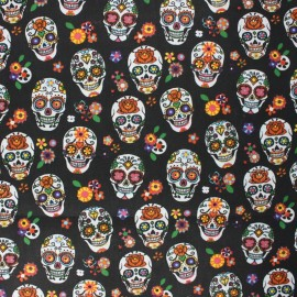 Coated cretonne cotton fabric - black skulls x 10 cm