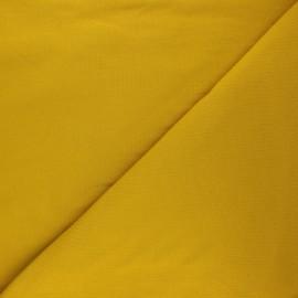 Tissu sweat Vera - jaune curry x 10cm