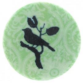 Bouton recouvert oiseau vert
