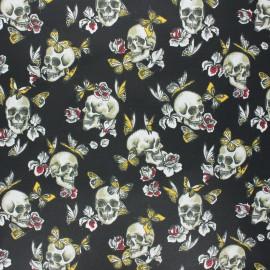 Coated cretonne cotton fabric - black Butterfly skull x 10cm