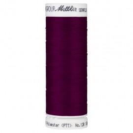 Elastic thread bobbin Mettler Seraflex 130m - N°1067 - red purple