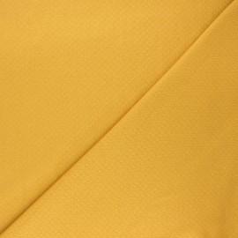 Tissu double maille ajourée - moutarde x 10cm