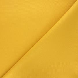 Tissu toile polyester imperméable souple Una - jaune moutarde x 10cm
