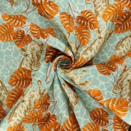 Twill viscose fabric - celadon blue Tropical giraffe x 10 cm