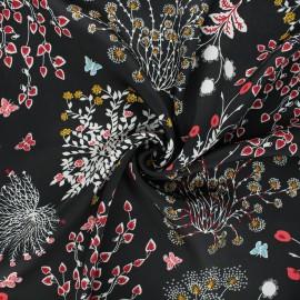 Print polyester satin fabric - black Floraison printanière x 10cm