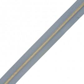 Fermeture Eclair® au mètre laiton - bleu gris