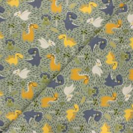 Printed jersey fabric - khaki green Happy dino x 10cm
