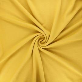 Tissu jersey viscose uni - jaune curry x 10 cm