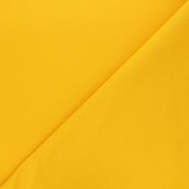Tissu sweat léger uni - jaune limoncello x 10cm