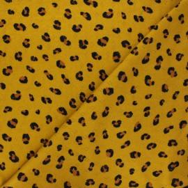 Poppy openwork jersey fabric - green Animal skin x 10cm
