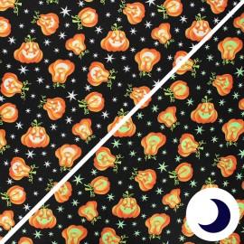 Phosphorescent cotton fabric Here we glow - black Pumpkins x 10cm
