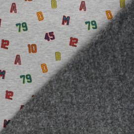 Tissu sweat envers minkee High school team - gris chiné x 10cm