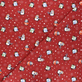 Printed jersey fabric - red Wintry penguins x 10cm