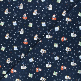 Printed jersey fabric - navy blue Wintry penguins x 10cm