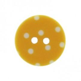 Bouton rond jaune à pois blancs