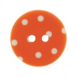 Bouton rond orange à pois blancs