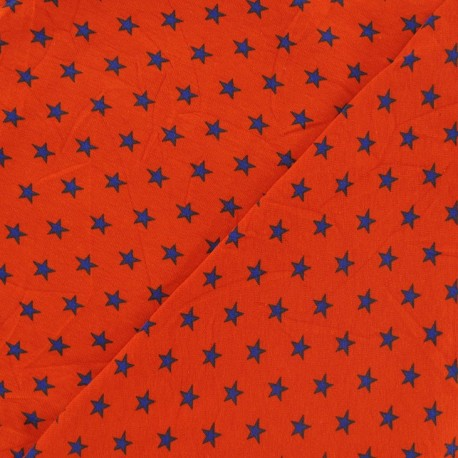 Tissu jersey étoile orange x 10cm