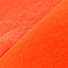 Tissu matelassé étoiles recto-verso orange fluo  x 10cm
