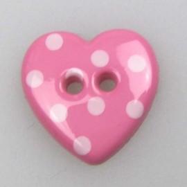 Bouton coeur rose à pois